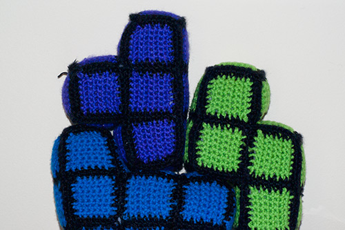 Crochet figures of Tetris blocks.